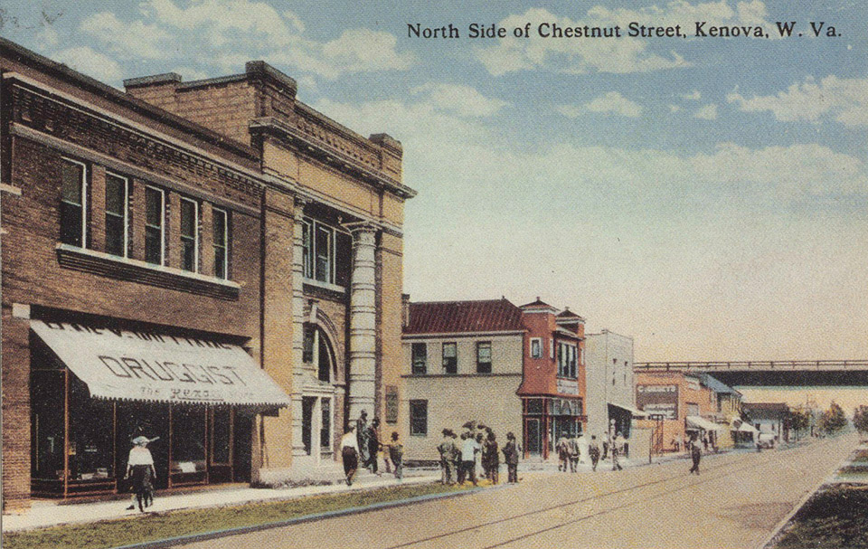 1924 view of the North Side of Chestnut Street, Kenova, W. VA.  Front left is R. Ney Williams Drug (now Griffith & Feil), First National Bank of Kenova, and Dr. Goff's Office.   Issued by Griffith & Feil Drugs, Kenova WV